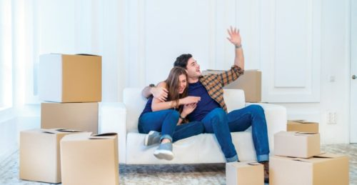Couple enjoying new home after moving using a man with a van