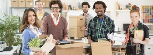 Employees packing for office removals