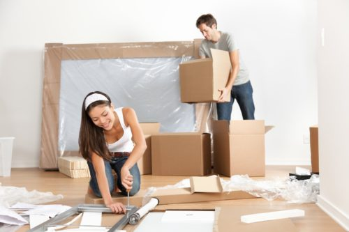 Couple moving to new home - packing for moving house