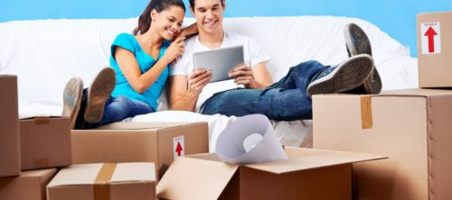 Couple looking for and comparing moving house quotes