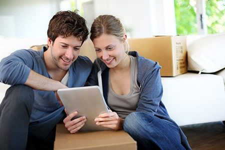 Couple looking at prices for house removals