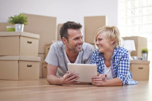 Couple comparing prices of moving companies